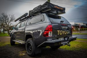 This keeps the overall height down which makes accessing the Darche Highview 2 roof top tent on top of the canopy just that little bit easier. & New Gen HiLux | TJM Hunter Valley